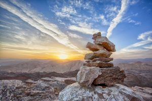 A photo shows a stack of rocks. This demonstrates concepts in depression treatment Virginia with Monday Courage.