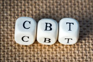 """Dice cubes read """"CBT."""" These dice add visual appeal to the page while emphasizing that our online therapists offer cognitive behavioral therapy in Virginia online."""